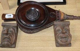 A 19th century set of mahogany bellows and a pair of carved corbels