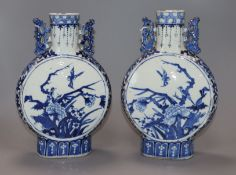 A pair of 19th century Chinese blue and white moon flasks, Kangxi marks, decorated birds and