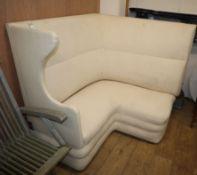 A 1920's corner wing sofa