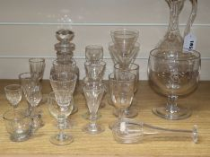 A group of assorted glassware including a claret jug, toddy lifter, decanters etc.