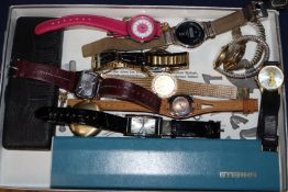 A group of assorted wrist and pocket watches including Eterna, Certina and Buler.