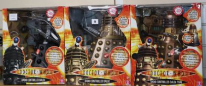 Doctor Who - Character Options - three radio controlled Daleks; model Thay 02484, 01629 and 02138,