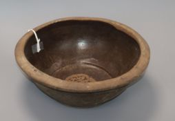 An Indonesian stoneware pottery bowl diameter 30cm