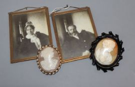 A jet framed cameo brooch, another and two photograph frames
