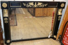 A 19th century Empire style ebonised and gilt metal mounted overmantel mirror with original glass