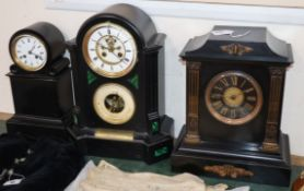 A black slate and green malachite clock, barometer and two other clocks tallest 42cm
