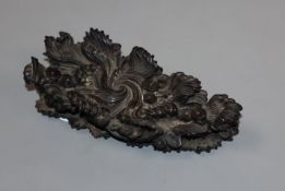 A Chinese rosewood stand, 19th century, carved as waves width 12cm