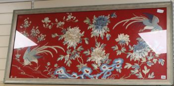 A Chinese embroidered silk picture of phoenix, peonies and rockwork 56 x 129cm excl. frame