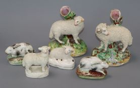 Two pairs of Staffordshire sheep and a pair of Staffordshire rabbits