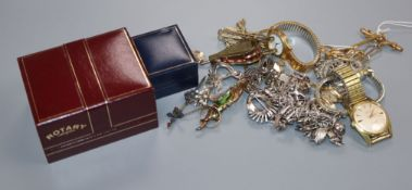 A group of mixed jewellery including a 9ct bar brooch, 18ct bar brooch, silver charm bracelet,