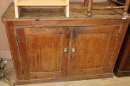 A Victorian pine two door cabinet W.120cm