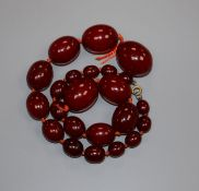 A single strand simulated cherry amber bead necklace ( needs re-stringing), gross weight, 69