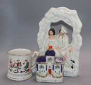 A Staffordshire figure group, a flatback castle and a frog mug and three musical mugs