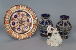 A pair of Doulton vases and a Derby Imari style plate and a Continental porcelain figural group