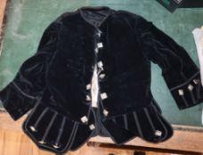A 19th century boy's black velvet jacket and matching waistcoat