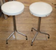 A pair of mid century chrome stools H.58cm