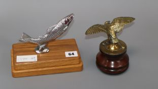 Two car mascots - a fish stamped Desmo and an eagle