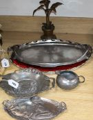 A Liberty Tudric dish and jug, a WMF tray, a Kayserzinn tray and one other, and a candlestick