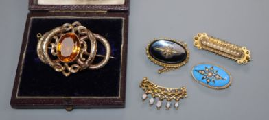 Four assorted late Victorian/Edwardian yellow metal and gem set brooches and a cased Victorian