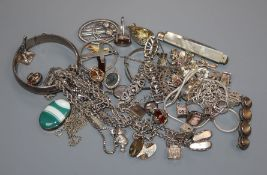 A group of assorted silver and white metal jewellery including charm bracelet.