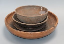 Two Chinese Straits brown-glazed bowls and two dishes