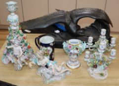 A pair of Meissen two branch candlesticks, a figural centrepiece, vase, Worcester style mug and a