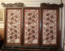 A large 19th century Javanese teak screen with Batik panels by Pamang 59cm
