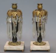 A pair of early Victorian ormolu and onyx lustre candlesticks height 24cm