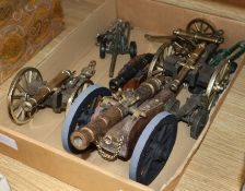 A group of brass cannons and toy artillery