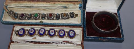 A gilt white metal and cabochon gem set bracelet, one other and a white metal bangle.