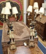 A pair of wood and composition Blackamoor table lamps