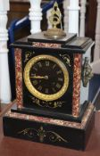 A Victorian black slate and marble mantel clock