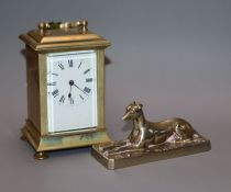 An Elkington and Co. paperweight and a small carriage timepiece