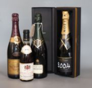 A bottle of Champagne, Moet and Chandon grand vintage 2004, a bottle of Bollinger 1996, a bottle