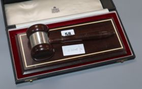 A Garrard silver mounted ceremonial gavel and stand, case stand width 28cm