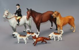 A Beswick lady horse rider, a fox and three hounds, a dog and a horse (7)