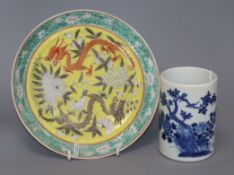 A 19th century Chinese blue and white brushpot, Xuande mark and a yellow ground 'dragon' plate