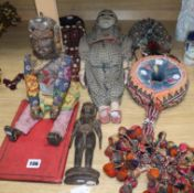 Two head dresses, an Indian carving, an Indian puppet, another Indian headdress, a wooden puppet and