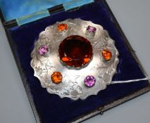 A cased late Victorian Scottish silver and coloured stone mounted kilt brooch by Robert Reid,