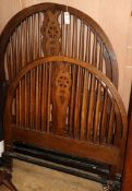 A pair of oak spindle and wheel back head and foot single bedsteads W.91.5cm
