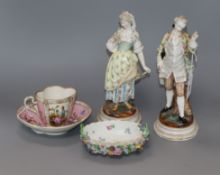 A pair of Dresden figures of a lady and gallant and a pink glazed cup and saucer and a dish