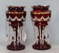 A pair of cranberry glass lustres height 37cm