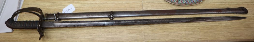 An E. Woods Officers dress sword presented by Serjt Major Mattham by his Comrades in Battery 4th F.