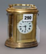 An Edwardian oval brass carriage clock, with travelling case height 13cm