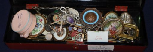 A lacquer box, containing assorted costume brooches, etc.