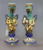 A similar pair of Cantagalli maiolica 'griffin' candlesticks height 34cm