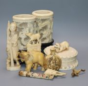 A Japanese carved ivory netsuke, a pair of pierced ivory vases, jar and cover, etc. (9)