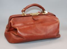 A brown leather Gladstone bag width 39cm