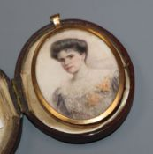 An Edwardian gilt framed oval oil on ivory miniature, portrait of a lady, cased