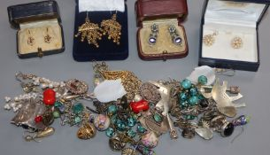 A box of assorted earrings, etc.